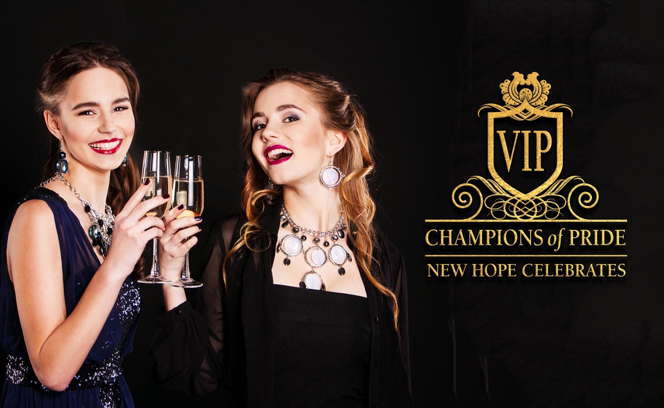 two stylish young women with glasses of champagne